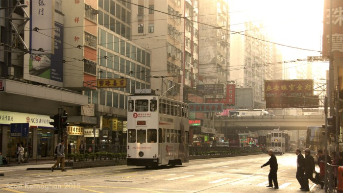 A tram travels along Hennessy Road on the main (Hong Kong) island late in the afternoon.