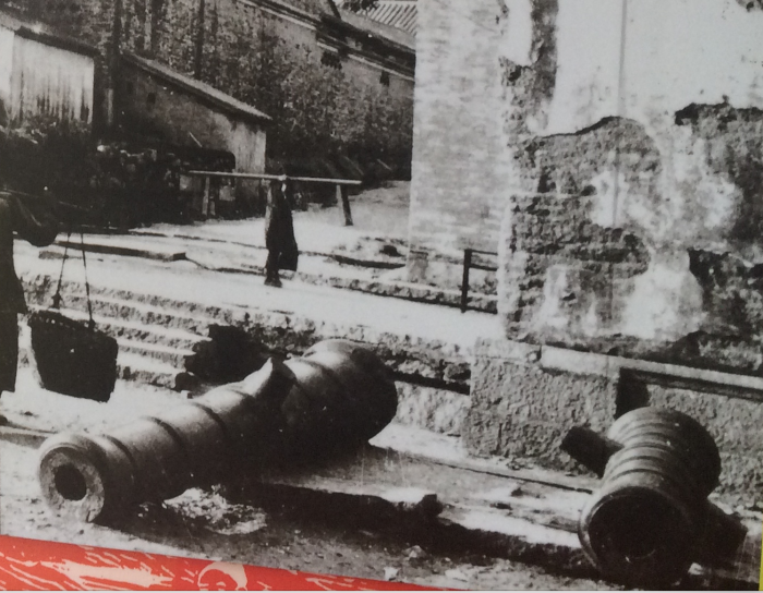 A photo of the cannons from the gatehouse laying discarded after the Japanese had demolished the gatehouse.