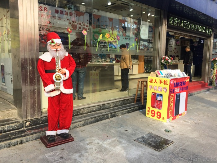 Because nothing says 'fake Samsung shop full of cloned Samsung products' like a one-armed sax playing Santa.